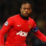 MANCHESTER, ENGLAND - MARCH 19:  Patrice Evra of Manchester United in action during the UEFA Champions League Round of 16 second round match between Manchester United and Olympiacos FC at Old Trafford on March 19, 2014 in Manchester, England.  (Photo by Laurence Griffiths/Getty Images)