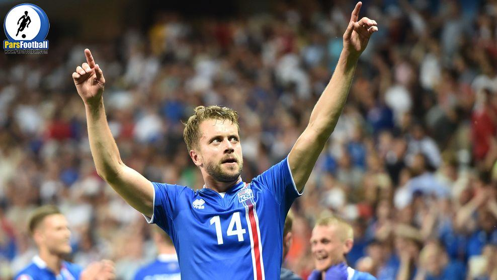 Iceland's defender Kari Arnason celebrates his team's win after the Euro 2016 round of 16 football match between England and Iceland at the Allianz Riviera stadium in Nice on June 27, 2016.  .Iceland won the match 1-2. / AFP / BERTRAND LANGLOIS        (Photo credit should read BERTRAND LANGLOIS/AFP/Getty Images)
