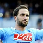 Napoli's Gonzalo Higuain celebrates after scoring during a Serie A soccer match between Napoli and Lazio, at the San Paolo stadium in Naples, Italy, Sunday, April, 13, 2014. (AP Photo/Salvatore Laporta)
