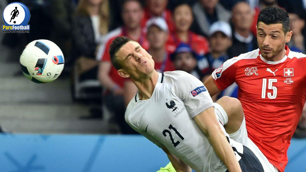 France's defender Laurent Koscielny (L) heads the ball next to Switzerland's midfielder Blerim Dzemaili during the Euro 2016 group A football match between Switzerland and France at the Pierre-Mauroy stadium in Lille on June 19, 2016. / AFP / PHILIPPE HUGUEN        (Photo credit should read PHILIPPE HUGUEN/AFP/Getty Images)