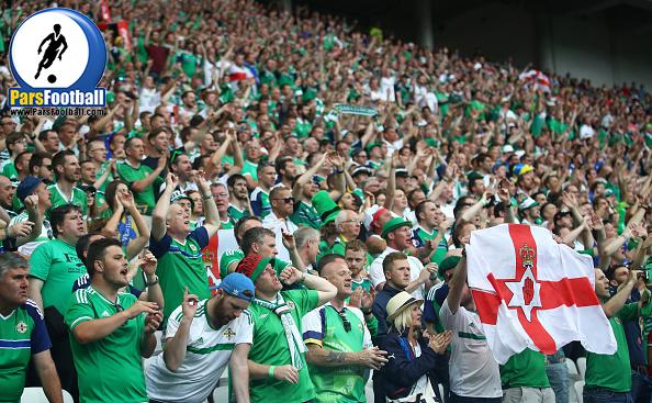 LYON, FRANCE - JUNE 16:  Northern Ireland supporters cheer during the UEFA EURO 2016 Group C match between Ukraine and Northern Ireland at Stade des Lumieres on June 16, 2016 in Lyon, France.  (Photo by Clive Brunskill/Getty Images)