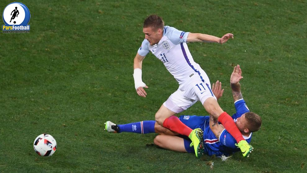 NICE, FRANCE - JUNE 27:  Ragnar Sigurdsson of Iceland tackles Jamie Vardy of England during the UEFA EURO 2016 round of 16 match between England and Iceland at Allianz Riviera Stadium on June 27, 2016 in Nice, France.  (Photo by Laurence Griffiths/Getty Images)