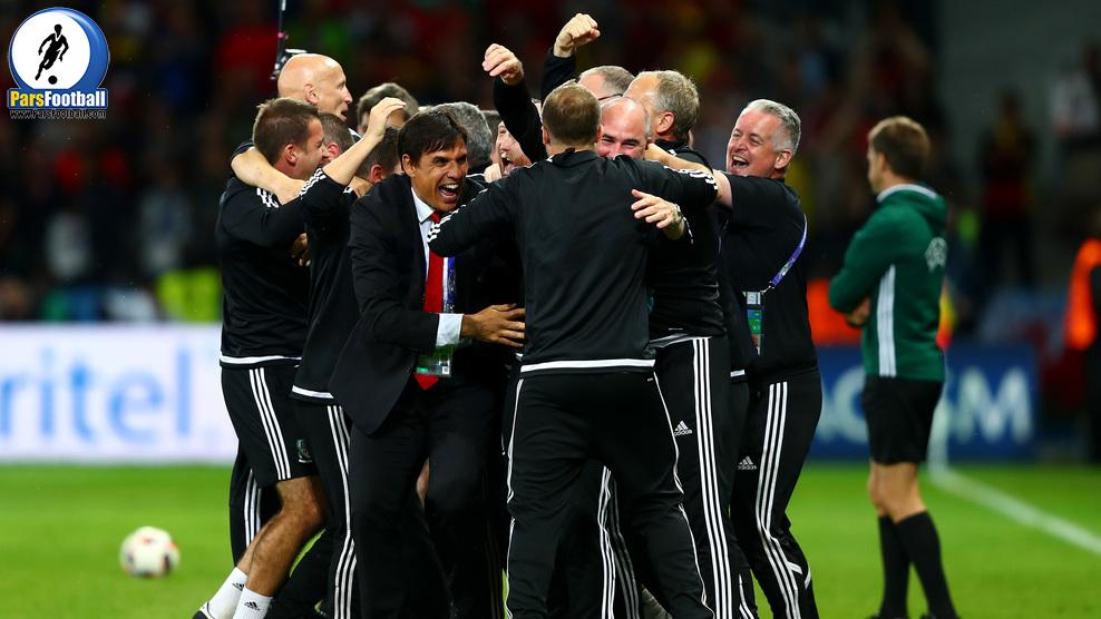 LILLE, FRANCE - JULY 01:  Manager Chris Coleman and Wales team staffs celebrate their team's 3-1 win after the UEFA EURO 2016 quarter final match between Wales and Belgium at Stade Pierre-Mauroy on July 1, 2016 in Lille, France.  (Photo by Clive Rose/Getty Images)