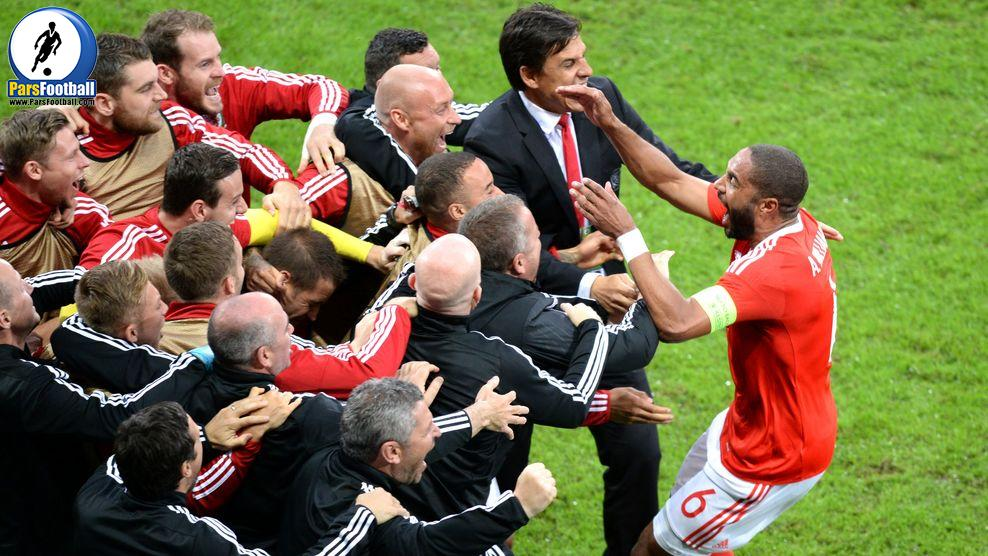Wales' defender Ashley Williams (R) celebrates with teammates after scoring a goal during the Euro 2016 quarter-final football match between Wales and Belgium at the Pierre-Mauroy stadium in Villeneuve-d'Ascq near Lille, on July 1, 2016. / AFP / Denis Charlet        (Photo credit should read DENIS CHARLET/AFP/Getty Images)