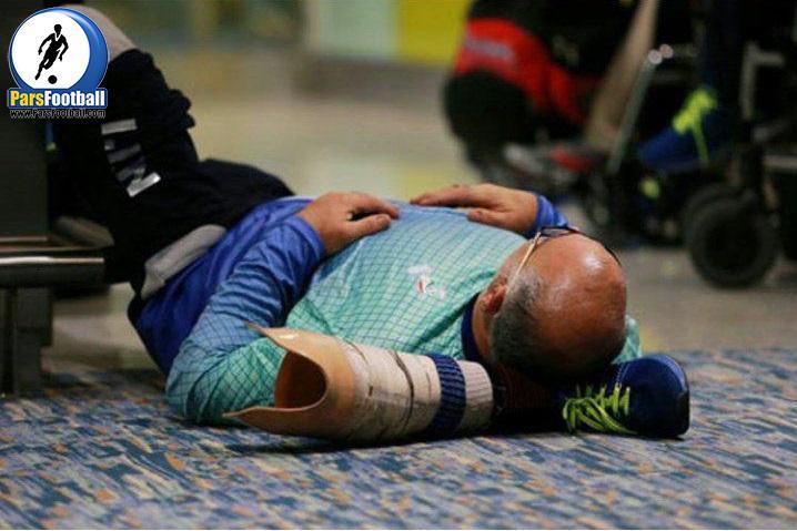 این عکس حسین امیری سرمربی تیم ملی تیراندازی جانبازان و معلولان